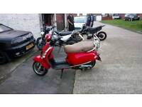 Baotian monza 125 very well maintained with 11 months mot
