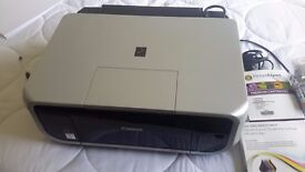 Canon Pixma MP600R printer/scanner with extra inks and instructions manuals. Excellent condition.
