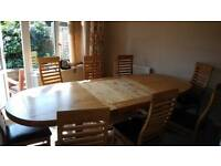 Solid oak dining table with 8 chairs and 2 blades to extend the table