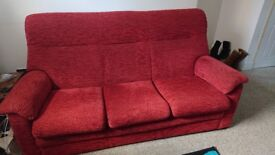 Red parker knoll three seater sofa.