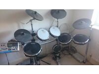 Alesis DM10 Electric Drum Kit with double bass drum pedals.