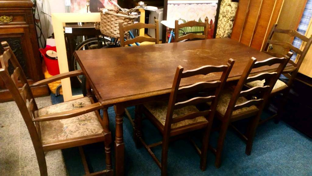 Priory table and six chairs two carvers in sale