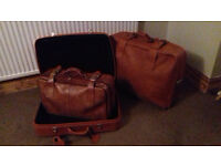3 leather suitcases