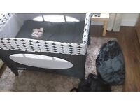Chicco OBaby travel cot with newborn section