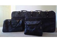Matching suitcases and travel bags.
