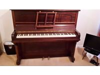 *Free* Hemingway Piano in good working condition - save me from the tip!
