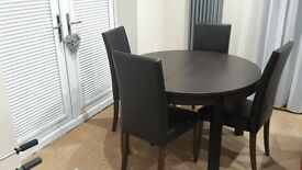 ikea extendable dining table and 4 faux leather faux chairs