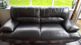 Harveys 3 seater black leather sofa, v.good condition, pet free house, £100.