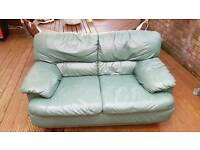 Green leather two seater sofa