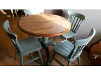 Round pine top table and 4 chairs