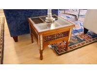 A Pair of 20th century Egyptian side tables with turned wood panels and decorative inlay borders
