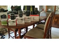 3 canon cameras and various canon lenses.. plus various camera accessories