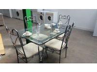 Lovely glass dining table with 6 chairs