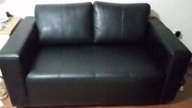 Just look like a new no any damage,scratch or marks.black leather sofa in an excellent condition