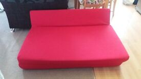 red futon in very good condition