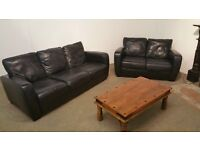 Black leather suite, three seater and two seater sofa