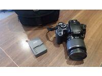 Canon EOS 400D Digital SLR Camera (incl. 28-90mm lens ).
