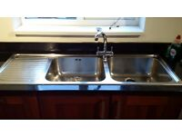 Franke double sink with draining board, and tap.