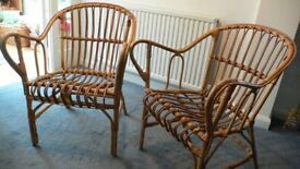 Pair of wicker/cane conservatory/garden chairs