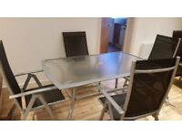 Large outdoor glass table + 4 chairs