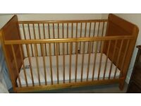 Mothercare wooden cot bed with adjustable height base and mattress