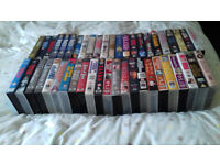 collection of VHS pre- recorded tapes