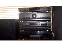 Stereo system plus 4 speakers
