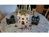 Lego Harry Potter 4842 Hogwarts, and 10217 Diagon Alley.