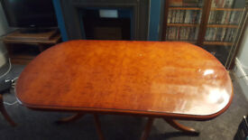 Yew wood dining table and 6 chairs. Has removable extension piece. Some scratches