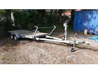 Flat bed trailer twin axle, braked. 26ft long approx.