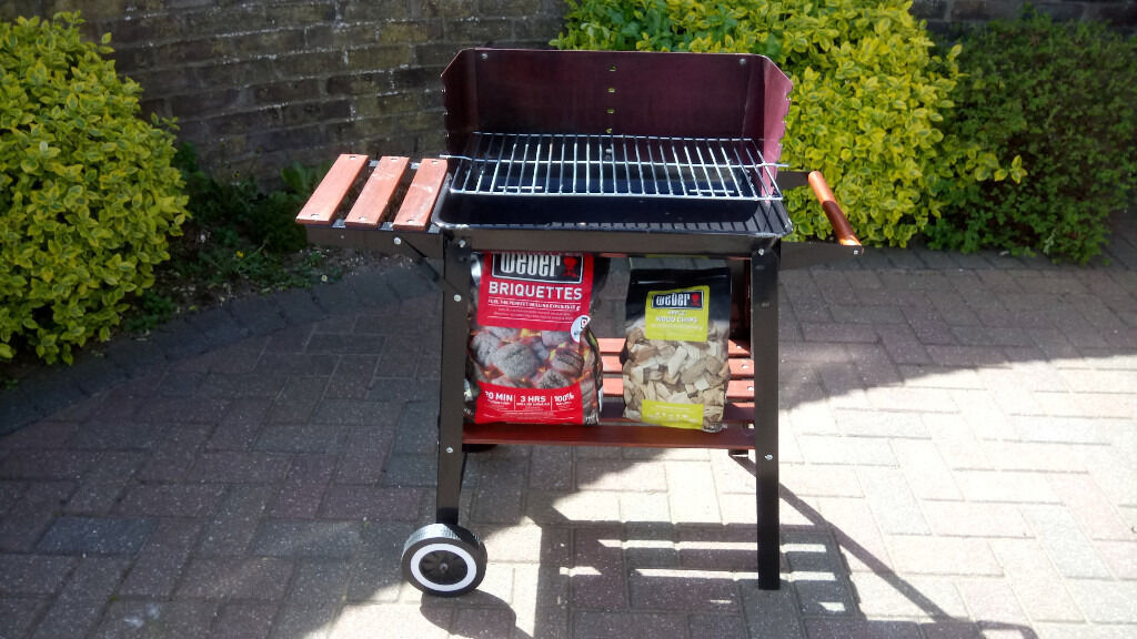 Landmann charcoal BBQ with Weber Briquettes and Apple wood chipsin Basingstoke, HampshireGumtree - For sale a Landmann Charcoal BBQ with a half bag of Briquettes and nearly a full bag of Apple wood chips also not showing is half a bottle of lighting gel. Only used on 4 occasions but have now switched to a gas BBQ