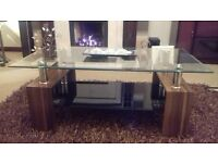 Glass Top coffee table with black glass paper rack finished in chrome