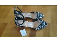 Brand new ladies black & white aztec design high heeled sandals, size 9.