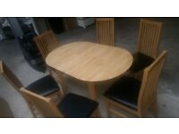 Thornbury Oval Extandable Dining Table and 4 Black Paris Chairs