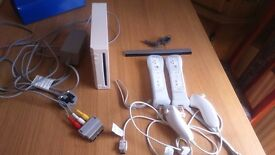 Wii Console plus 2 controllers, 5 games and a Wii fit balance board