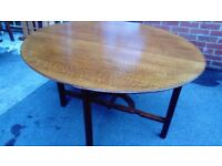 Beautiful dark wood oval side folding table in lovely condition a rare example