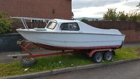 15 ft cabin boat reduced for quick sale. reduced even more///////