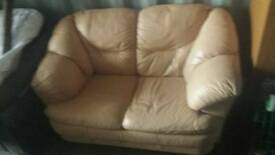 Salmon coloured 2 seater sofa