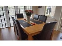 Oak dining table & 6 leather chairs for sale - good condition. £200 ONO
