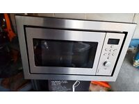 Integrated microwave oven grill.