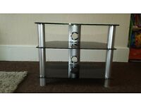 Basically new, Black glass 3 tier tv stand.