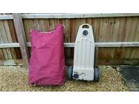 Wastemaster waste water carrier and purple canvas carry bag.