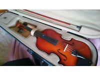 Half size violin in case, good condition