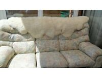 3 seat floral patterened sofa