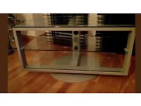TV stand rotates and has glass shelves £15