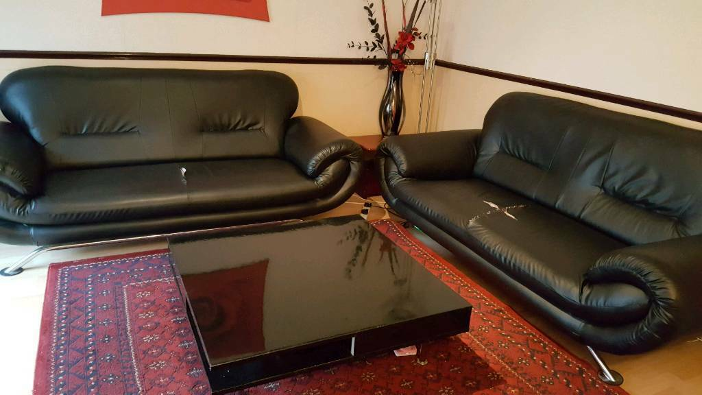 FREE 2 x 3 seater black leather sofa's