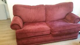 Red 2 seater sofa and matching armchair