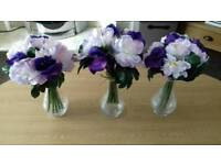 3 Glass vases with 3 bunches of purple and lilac artificial flowers