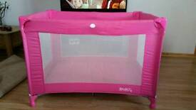 Pink travel cot and thick travel cot mattress