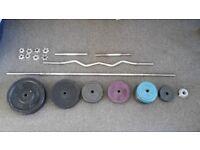 150 kg of Weights in steel + barbells + dumbbell
